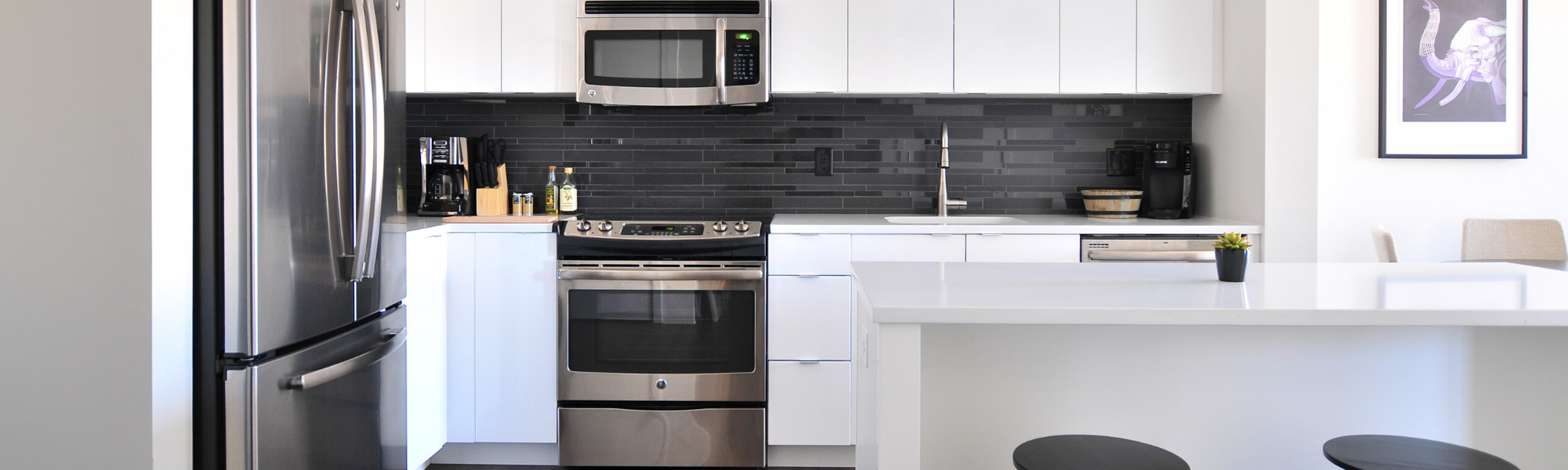 Information for sellers header image showing a white and stainless steel bright kitchen.